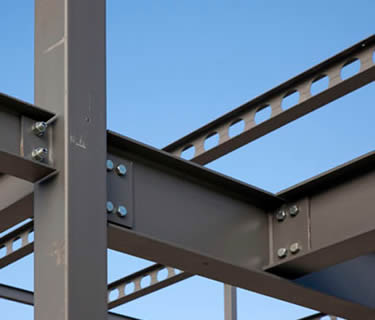 Dark grey painted A992 H beam as the frame for a steel structure