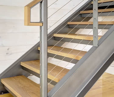 Steel channel stringers stair with cable railing